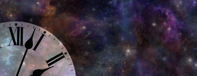 A section of a clock placed in front of a starry sky.